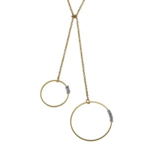 "Dainty gold tone lariat style necklace accented with two wire wrapped circles. Approximately 28"" in length."