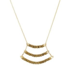 "Worn gold tone necklace featuring a wire wrapped triple bar pendant accented with gold tone beads. Approximately 32"" in length."