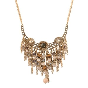 "Gold tone double stranded necklace featuring a curved casting with topaz and gray rhinestones and a cluster of metal fringe and ivory and brown beads. Approximately 26"" in length."