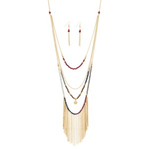 "Gold tone layering necklace set with navy, gray, burgundy, and brown beads and metal fringe. Approximately 34"" in length."
