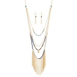 "Gold tone layering necklace set with multicolored beads and metal fringe. Approximately 34"" in length."