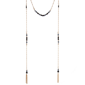"Gold tone layering necklace set displaying black and blue bead stations with chain tassels at the end. Approximately 38"" in length."