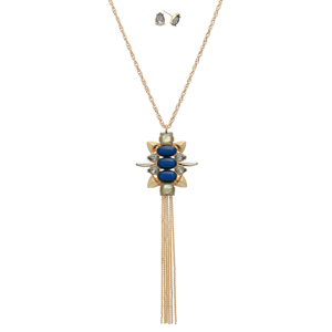 "Burnished gold tone necklace set displaying a pendant with navy and beige cabochons, clear rhinestones, and a metal tassel. Approximately 29"" in length."