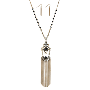 "Burnished gold tone necklace set displaying black beads and a decorative pendant with chain fringe. Approximately 30"" in length. Additional 6"" with pendant and fringe."