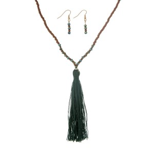 "Brown and green beaded necklace set with a hunter green fabric tassel. Approximately 32"" in length."