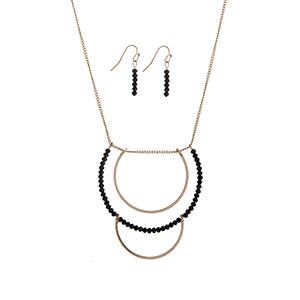 "Gold tone necklace set displaying layered half rings with black bead accents. Approximately 33"" in length."
