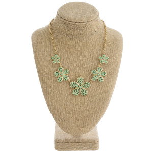 "Gold tone necklace set displaying mint green filigree design flowers. Approximately 16"" in length."