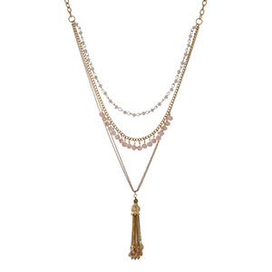 "Two tone layering necklace set with ivory and peach beads and a capped 2"" chain tassel with beads. Approximately 39"" in length."