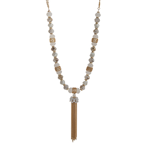 "Gold tone double strand necklace white and gray beads with a chain tassel. Approximately 30"" in length."