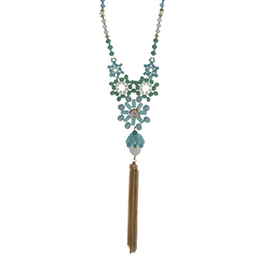 "Gold tone half beaded necklace with turquoise and white beads displaying flowers with a rhinestone and hanging chain tassel. Approximately 30"" in length."