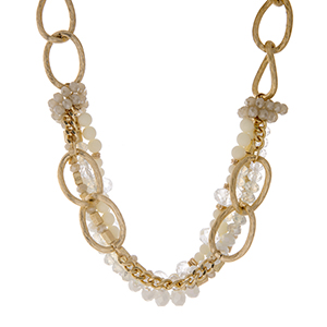 "Gold tone chain link layering necklace with rows of clear and white beads. Approximately 16"" in length."