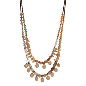 "Peach, green, and gray, beaded layering necklace displaying beige chipstone, gold tone  leaves, and gold tone disk. Approximately 18"" in length."