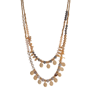 "Gray, ivory, and gold tone beaded layering necklace displaying beige chipstone, gold tone leaves, and gold tone disk. Approximately 18"" in length."