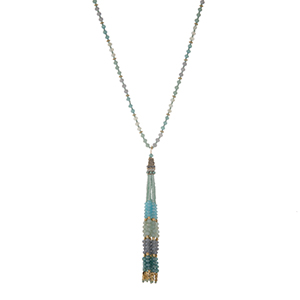 "Gold tone half beaded necklace displaying light blue, gray, and gold tone beads with a 4 1/4"" beaded tassel. Approximately 32"" in length."