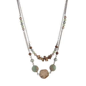 "Silver tone layering necklace with ivory, green, and brown beads and natural stone. Approximately 16"" in length."