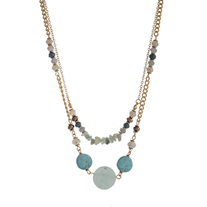 "Gold tone layering necklace with ivory, turquoise, and brown beads and natural stone. Approximately 16"" in length."