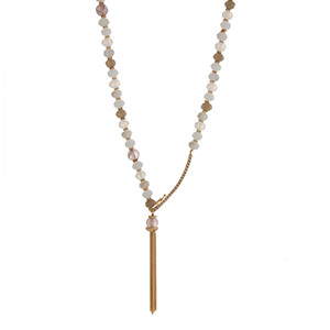 """Ivory and gray glass bead necklace displaying a gold tone pave bar with a latch and a chain tassel. Approximately 29"""" in length."""