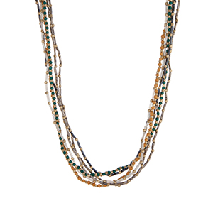 "Multiple strand teal, natural, and gold tone beaded necklace. Approximately 34"" in length."