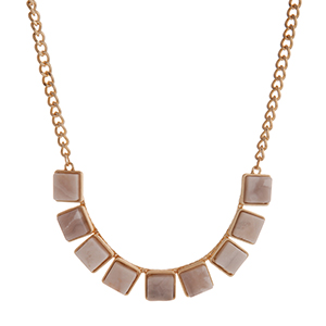 """Gold tone necklace displaying white square natural stones. Approximately 16"""" in length."""