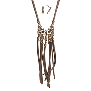 "Light brown cord necklace set displaying a gold tone casting with linked tassels. Approximately 28"" in length."