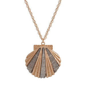"""Gold tone necklace with a 1 3/4"""" seashell pendant wrapped with silver tone wire. Approximately 30"""" in length."""