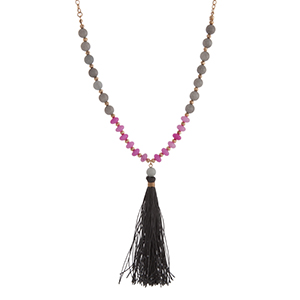 "Gold tone half beaded necklace displaying gray and fuchsia stone beads with a 3 1/2"" gray fabric tassel. Approximately 29"" in length."
