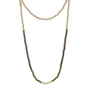 "Gold and green beaded layering necklace. Approximately 35"" in length."