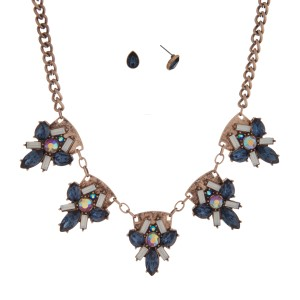 "Burnished gold tone necklace set with navy and opal floral shaped cabochons. Approximately 16"" in length."
