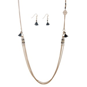 "Gold tone necklace set displaying black and white seed bead stations and black mini tassels with the matching earrings. Approximately 35"" in length."