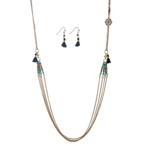 "Gold tone necklace set displaying blue and mint seed bead stations and navy blue mini tassels with the matching earrings. Approximately 35"" in length."