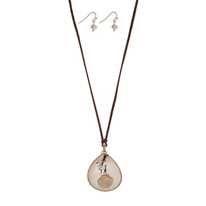 """Adjustable brown cord necklace set displaying a white teardrop shape pendant with a cluster of faux pearls and a gold tone seashell. Approximately 24"""" in length."""