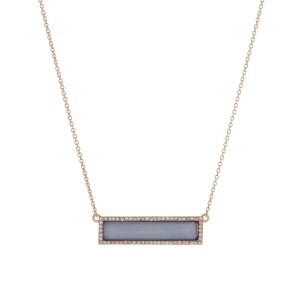 "Gold tone necklace displaying a shimmering blue bar with a halo. Approximately 16"" in length."
