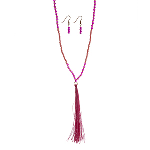 "Pink and fuchsia beaded necklace set with a fuchsia fabric 4 3/4"" tassel. Approximately 32"" in length."