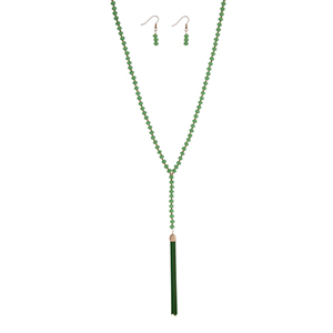 "Green beaded necklace set with a 3 1/4"" chain tassel. Approximately 32"" in length."