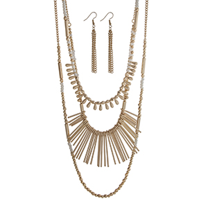 "Gold tone layering necklace set displaying white and gold beads and metal fringe. Approximately 33"" in length."