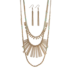 "Gold tone layering necklace set displaying mint and gold beads and metal fringe. Approximately 33"" in length."