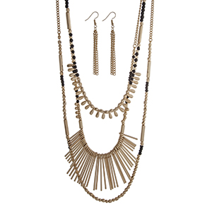 "Gold tone layering necklace set displaying black and gold beads and metal fringe. Approximately 33"" in length."