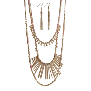 "Gold tone layering necklace set displaying pink and gold beads and metal fringe. Approximately 33"" in length."