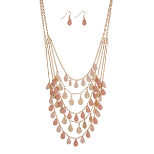 "Gold tone layering necklace set with rows of hammered and pink teardrop shapes. Approximately 30"" in length."