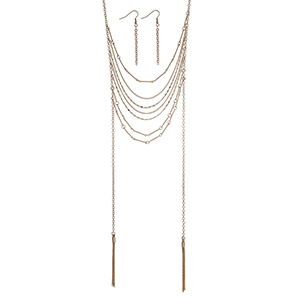 "Gold tone layering necklace set displaying draped of chains with two metal 2"" tassels. Approximately 28"" in length."