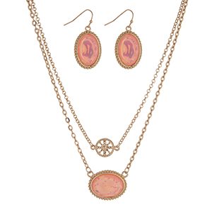 "16"" Gold tone necklace set with a pink oval pendant and matching 1"" earrings."