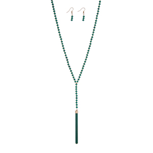 "Turquoise beaded necklace set with a 3 1/4"" chain tassel. Approximately 32"" in length."
