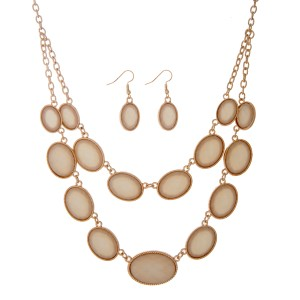 """Gold tone layering necklace set displaying shimmering ivory oval shaped cabochons. Approximately 22"""" in length."""