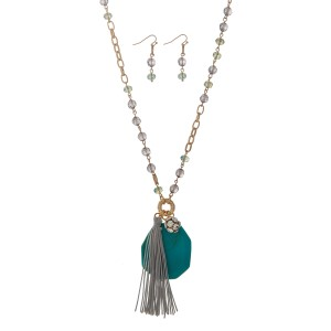"Gold tone necklace set displaying gray and green beads with a turquoise natural stone, a pave ball, and a gray 3"" fabric tassel. Approximately 36"" in length."