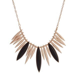 """Gold tone necklace set with hammered spikes and three black cabochons. Approximately 16"""" in length."""
