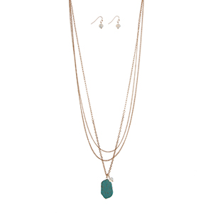 """Gold tone layering necklace set displaying a white bead and a turquoise natural stone. Approximately 33"""" in length."""