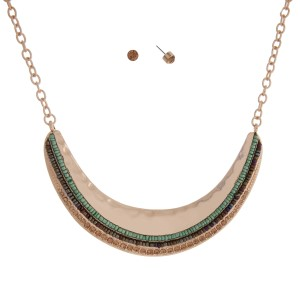 "Gold tone necklace set displaying a hammered crescent with green and gray seed beads and topaz rhinestones. Approximately 15"" in length."
