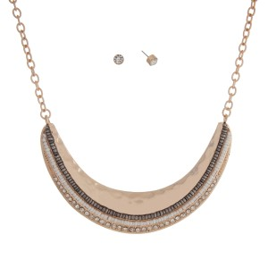 "Gold tone necklace set displaying a hammered crescent with gray and white seed beads and rhinestones. Approximately 15"" in length."