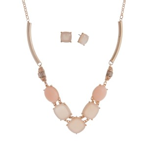 "Gold tone necklace set displaying pale pink cabochons with two rhinestone stations. Approximately 18"" in length."