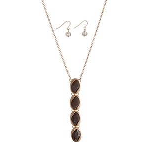 """Gold tone necklace set displaying four linked gray cabochons. Approximately 32"""" in length."""